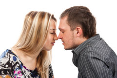 Portrait of a beautiful young happy couple kissing Stock Photo
