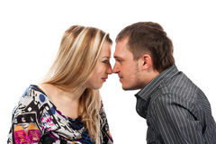 Portrait of a beautiful young happy couple kissing Stock Photos