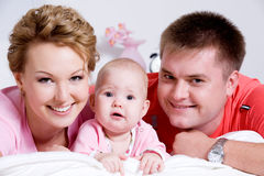 Portrait of the Beautiful young happy family Royalty Free Stock Photo