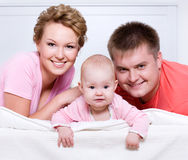 Portrait of the Beautiful young happy family Stock Photography