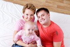 Portrait of the Beautiful young happy family Stock Photo