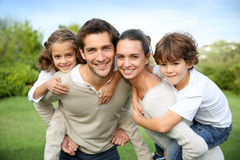 Portrait of beautiful young happy family outdoors Stock Photo