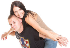 Portrait of a beautiful young happy smiling couple isolated Royalty Free Stock Image