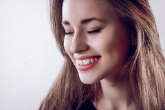 Portrait of beautiful young happy smiling woman with long hair Stock Photos