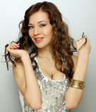 Portrait of beautiful young happy woman in disco grey dress Royalty Free Stock Photo