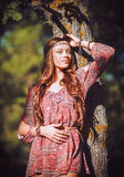 Portrait of beautiful young hippie girl standing near tree Royalty Free Stock Photos