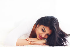 Portrait of beautiful young indian woman on carpet Royalty Free Stock Photos