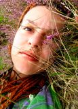 Portrait of a beautiful young lady. On the grass Stock Image