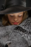 Portrait beautiful young lady in grey fur and hat Stock Photos