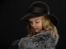 Portrait beautiful young lady in grey fur and hat Royalty Free Stock Image