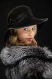 Portrait beautiful young lady in grey fur and hat Royalty Free Stock Photography