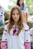 Portrait of beautiful young lady having fun dressed in embroidery fashion hand made shirt or dress Royalty Free Stock Photos