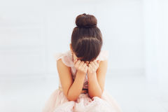 Portrait of beautiful young lady hiding her face Royalty Free Stock Images