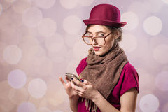 Portrait of beautiful young lady holding mobile and glasses Stock Photos