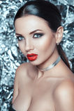 Portrait of beautiful young lady with luxury makeup and stylish accessory on her neck royalty free stock photo
