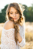 Portrait of a beautiful young lady model in field Stock Photography