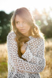 Portrait of a beautiful young lady model in field at sunset Royalty Free Stock Images