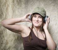 Portrait of a beautiful young lady smiling listening music Stock Photos