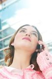 Portrait of a beautiful young lady talking on mobile phone in the city Stock Photo