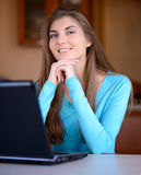 Portrait of a beautiful young lady working with laptop Royalty Free Stock Image