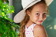 Portrait of a beautiful young little girl on the background of s. Ummer park. Cute kid Girl enjoying sunny summer holidays vacation outdoor Stock Image