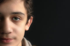 Portrait of beautiful young man. Affectionate glance with a smile on the face of a teenager Royalty Free Stock Photography