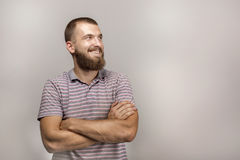 Portrait of a beautiful young man with a beard in his daily shirt. The man is smiling dreamily royalty free stock photography