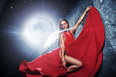Portrait of a beautiful young model over the giant moon. Portrait of a beautiful young woman over the giant moon Royalty Free Stock Photos