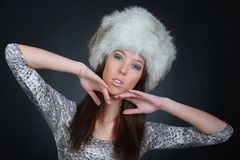 Portrait of a beautiful young model in winter fur hat Stock Photo