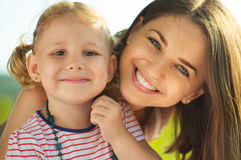 Portrait of a beautiful young mother and her little baby daughte Royalty Free Stock Photography