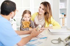 Little Girl Visiting Doctor with Mother royalty free stock photos
