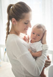 Portrait of beautiful young mother holding newborn baby at big w Stock Photography