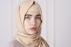 Portrait of a beautiful young Muslim woman wearing a hijab on her head Royalty Free Stock Images