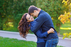 Portrait of beautiful young pair in a park Stock Images