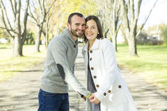 Portrait of beautiful young pair in a park Royalty Free Stock Photos
