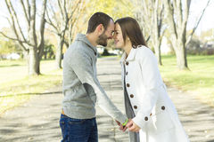 Portrait of beautiful young pair in a park Royalty Free Stock Photography