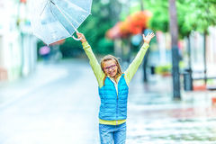 Portrait of beautiful young pre-teen girl with umbrella under rain Royalty Free Stock Image