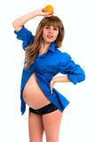 Portrait of a beautiful young pregnant woman with an orange Royalty Free Stock Photos