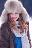 Portrait of beautiful young redhair woman in snow scenery Royalty Free Stock Image