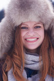 Portrait of beautiful young redhair woman in snow scenery Royalty Free Stock Images