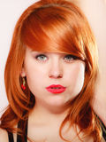 Portrait beautiful young redhaired woman. Long hair on pink Royalty Free Stock Photography
