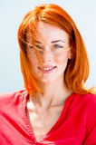 Portrait of a beautiful young redhead woman. With blue eyes and freckles Royalty Free Stock Photography