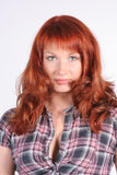 Portrait of beautiful young redheaded woman Stock Photography