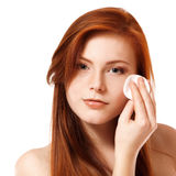 Portrait of beautiful young redheaded woman delete cosmetics wit Royalty Free Stock Photography