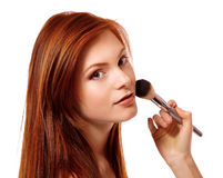 Portrait of beautiful young redheaded woman with esthetician mak Stock Images