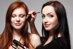 Portrait of beautiful young redheaded woman with esthetician mak Royalty Free Stock Photos
