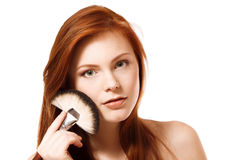 Portrait of beautiful young redheaded woman with makeup brush Royalty Free Stock Image