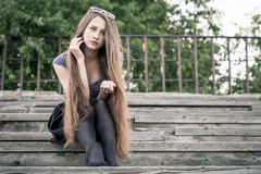 Portrait of a beautiful young sad hipster girl  outdoors Stock Images
