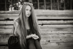 Portrait of a beautiful young sad hipster girl  outdoors Royalty Free Stock Image