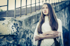 Portrait of a beautiful young sad hipster girl  outdoors Royalty Free Stock Photo
